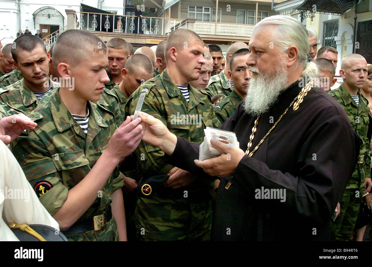 Father Viktor talks to Marines of Pacific Fleet who have arrived for small religious procession at St Nicholas Cathedral - Stock Image