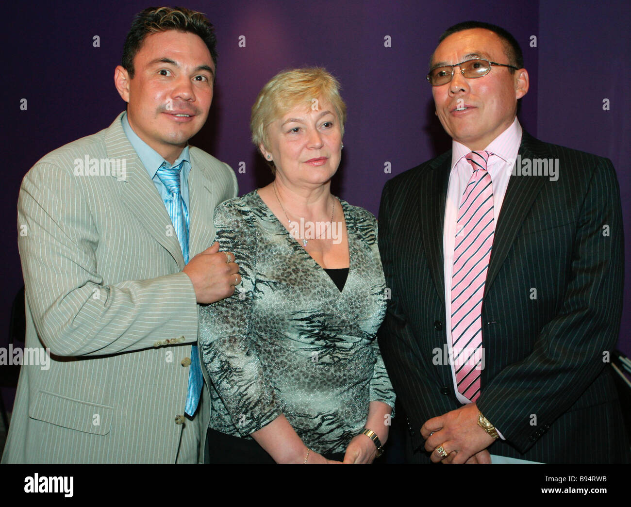 Absolute super lightweight boxing champion Konstantin Tzyu left with his parents at the International House of Music - Stock Image
