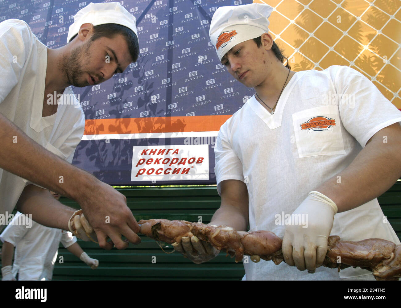 The longest chicken shashlik 70 meters made of 150 kg of poultry by 25 cooks has made it into the Guinness Book - Stock Image