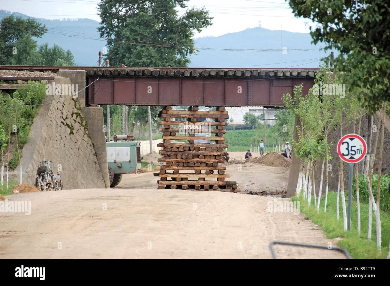 Railway bridge with a temporary support for maintaining its bearing capacity at one of the Tumangan Najin strips - Stock Image
