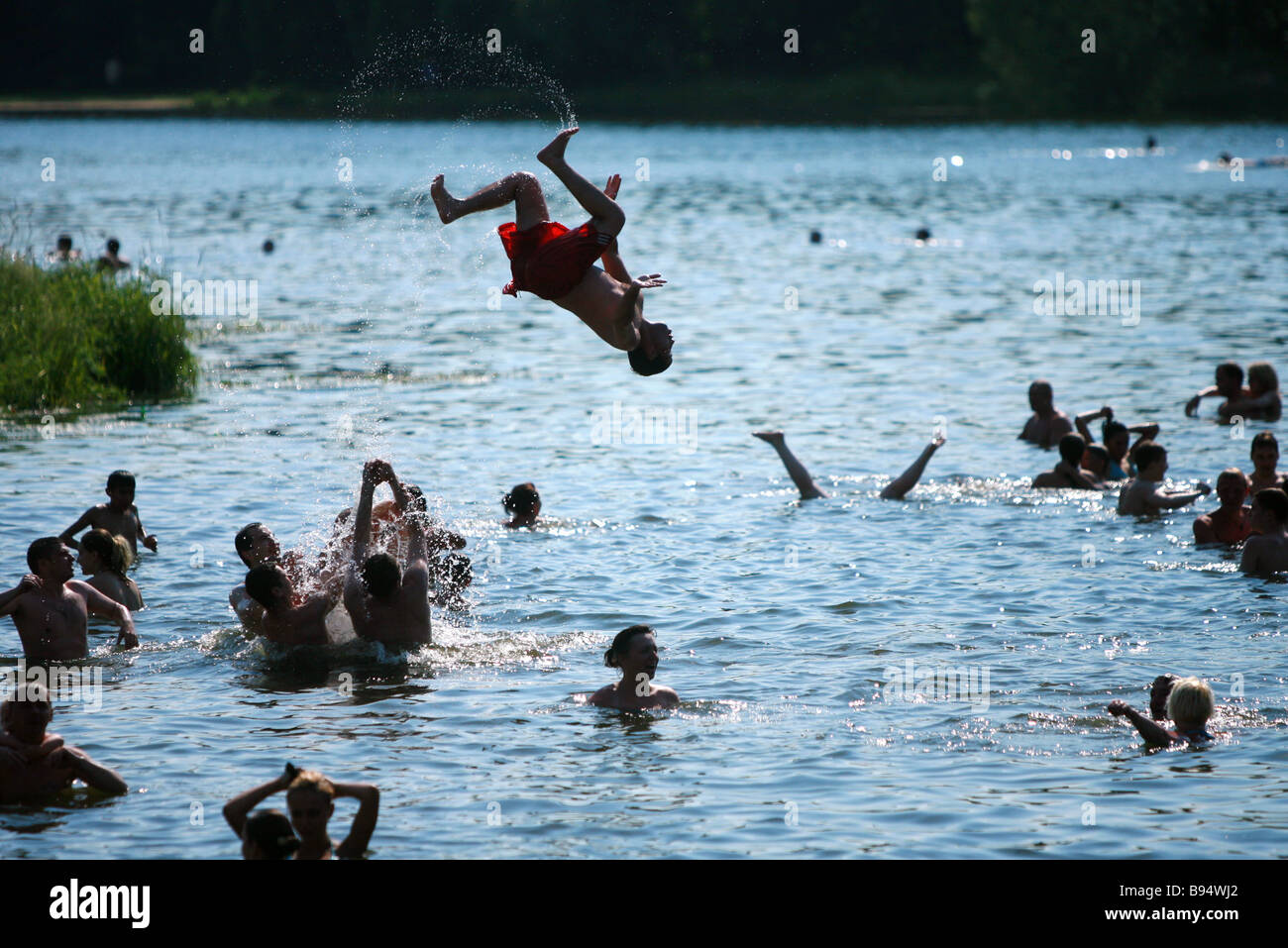Stunt swimming in a lake near Moscow - Stock Image