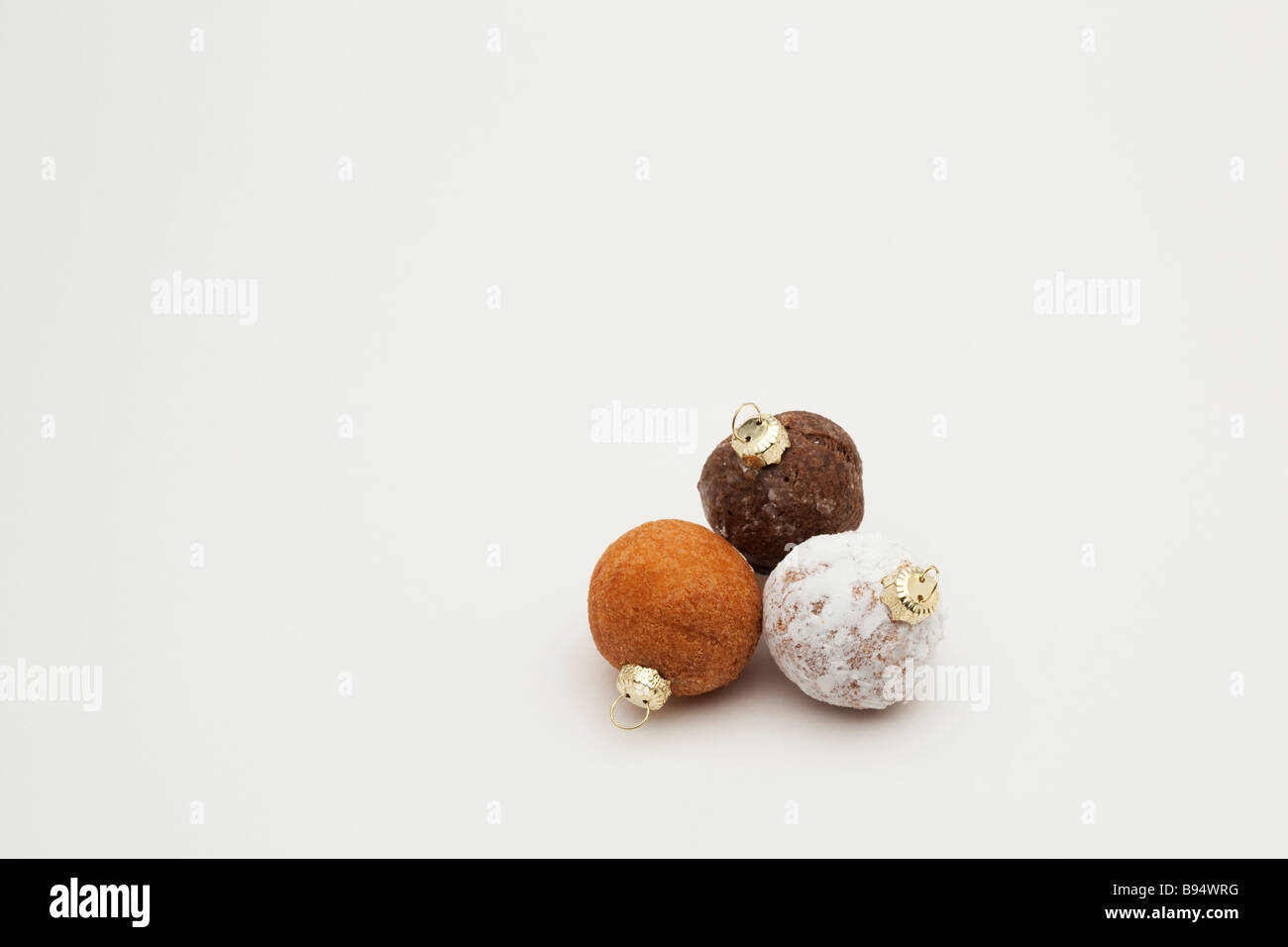 Christmas Ornament Tops.Three Donut Holes With Christmas Ornament Tops Stock Photo