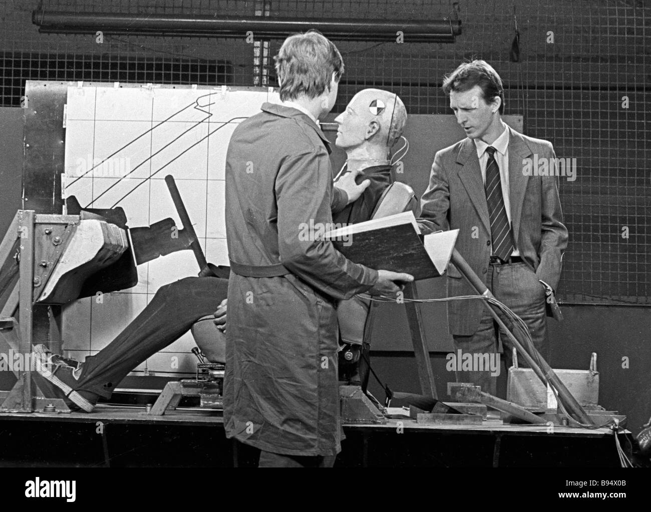 The Moscow Lenin Komsomol automobile plant s designers discussing the construction of a driver seat Stock Photo