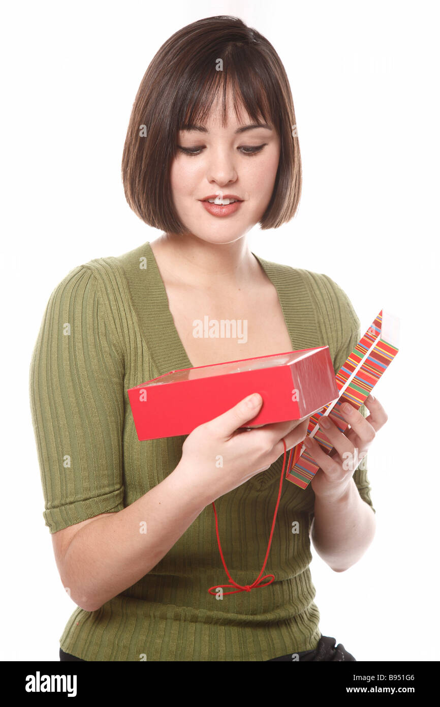 Woman looking at gift box - Stock Image