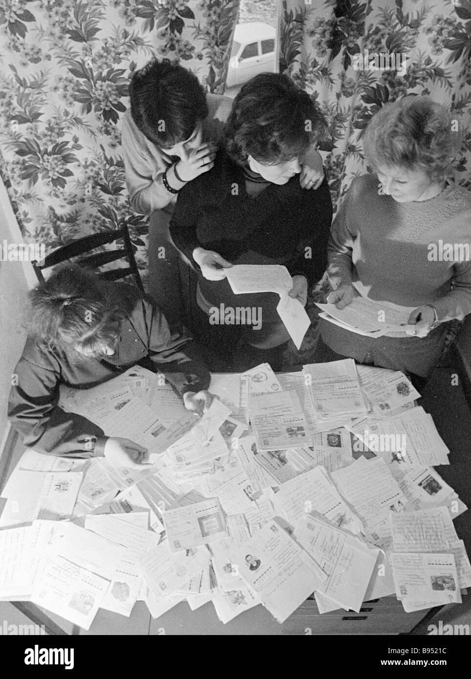 Editorial staff of the children s magazine Kolobok reading letters written by children - Stock Image