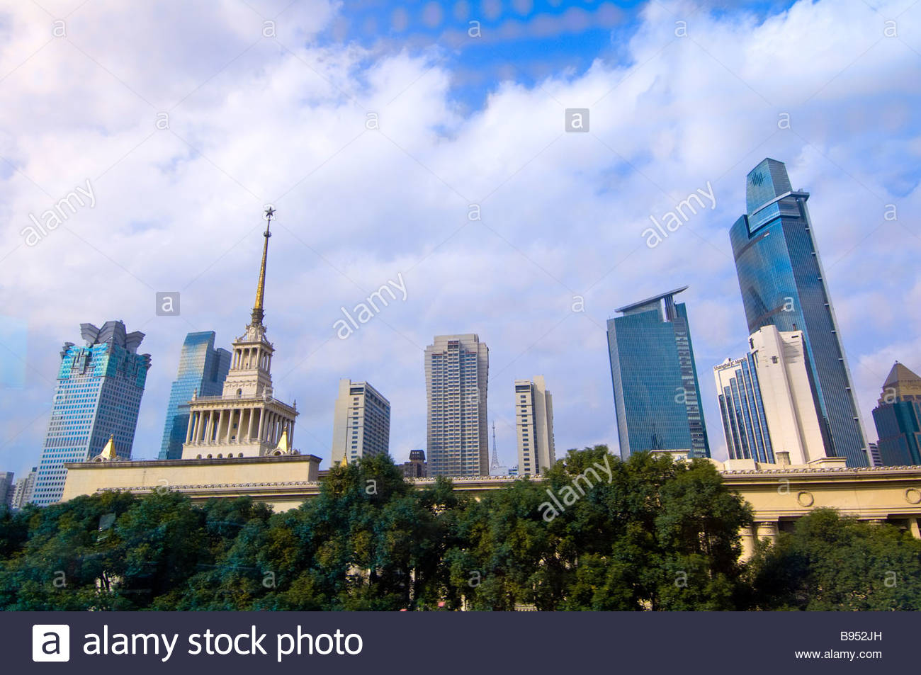 The Shanghai Exhibition Center Stalinist architecture in foreground with modern skyscapers behind Shanghai China - Stock Image