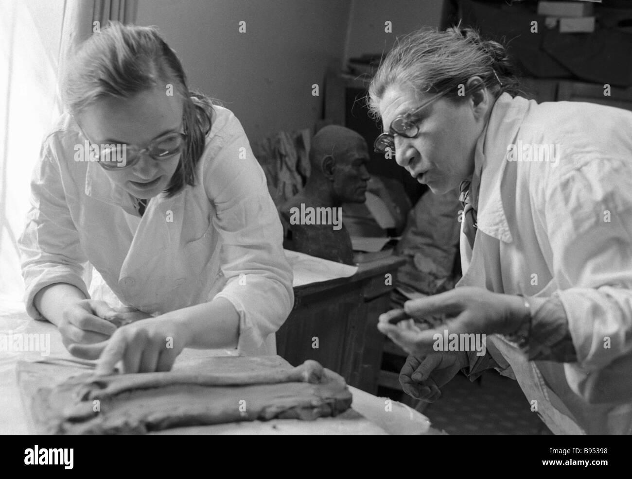 Taking a bone cast from an ancient burial anthropological plastic reconstruction laboratory Nikolai Miklukho Maklai - Stock Image