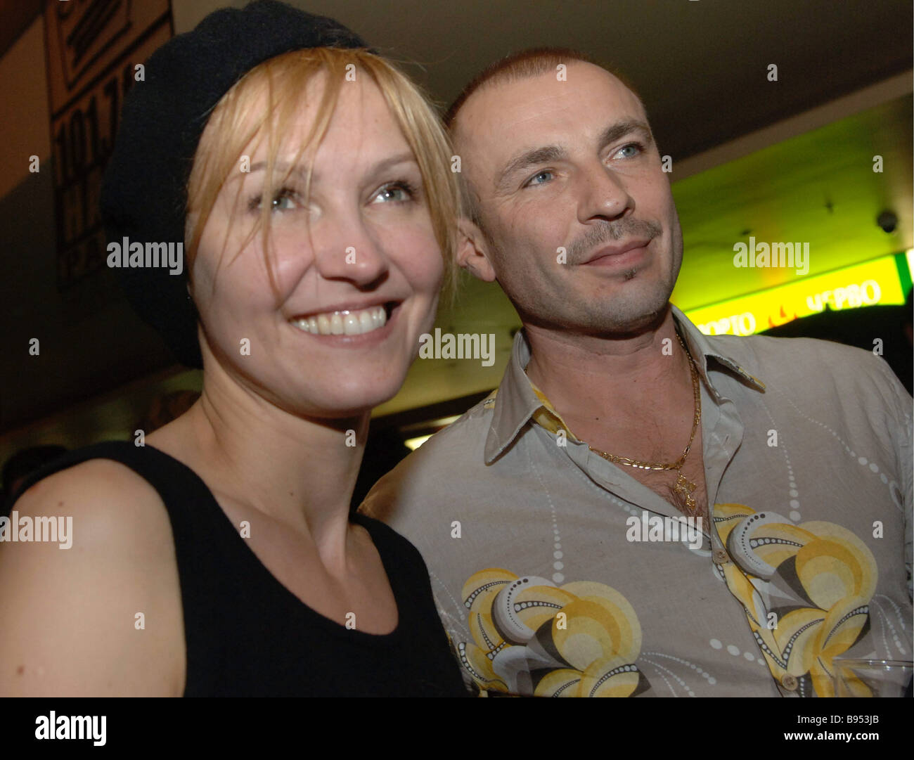 Russian film star Ingeborga Dapkunaite and figure skating trainer Alexander Zhulin at the Oktyabr cinema Moscow - Stock Image