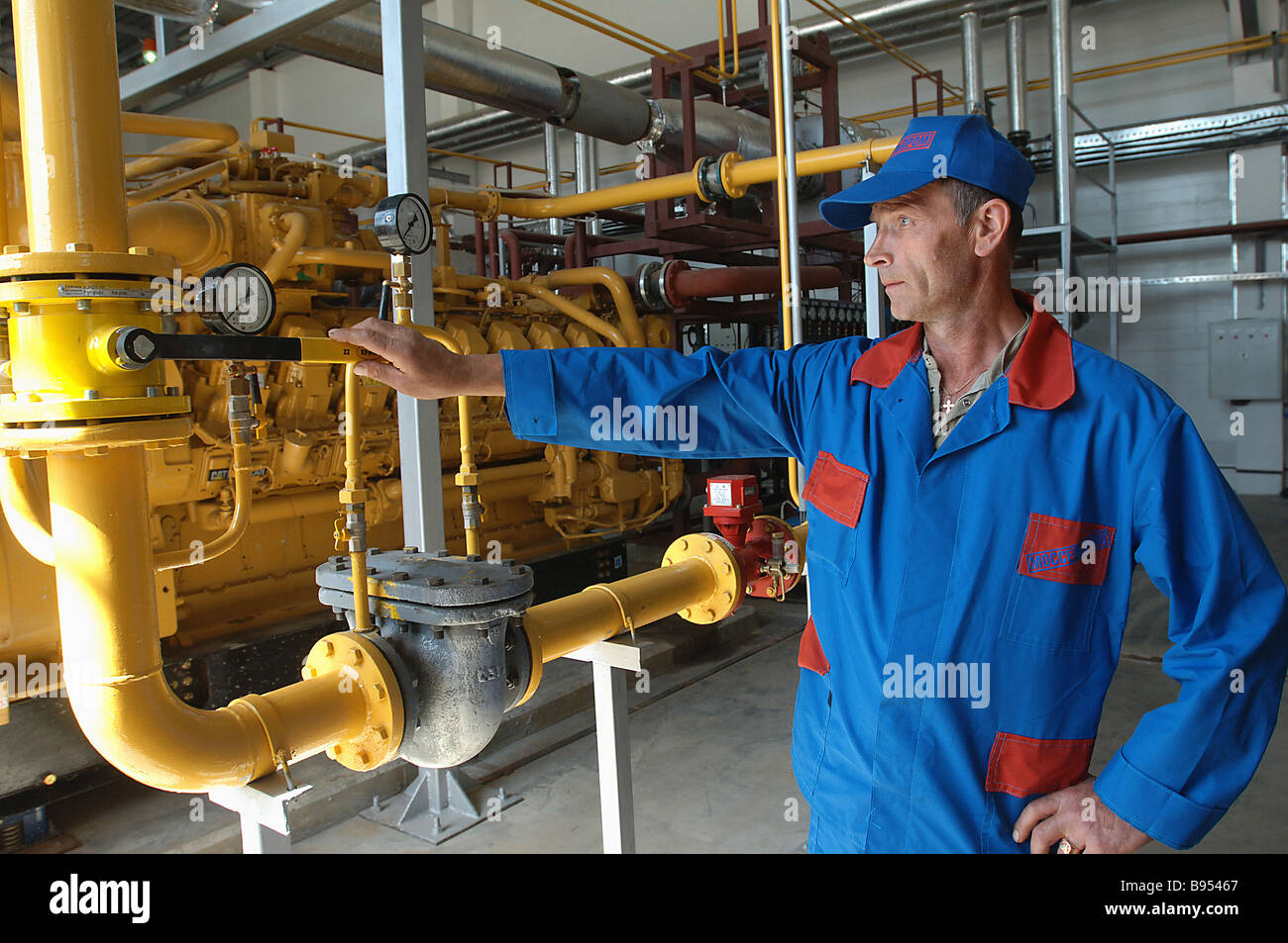 An electrician of the power supply unit at a poultry processing factory of the Mosselprom firm - Stock Image