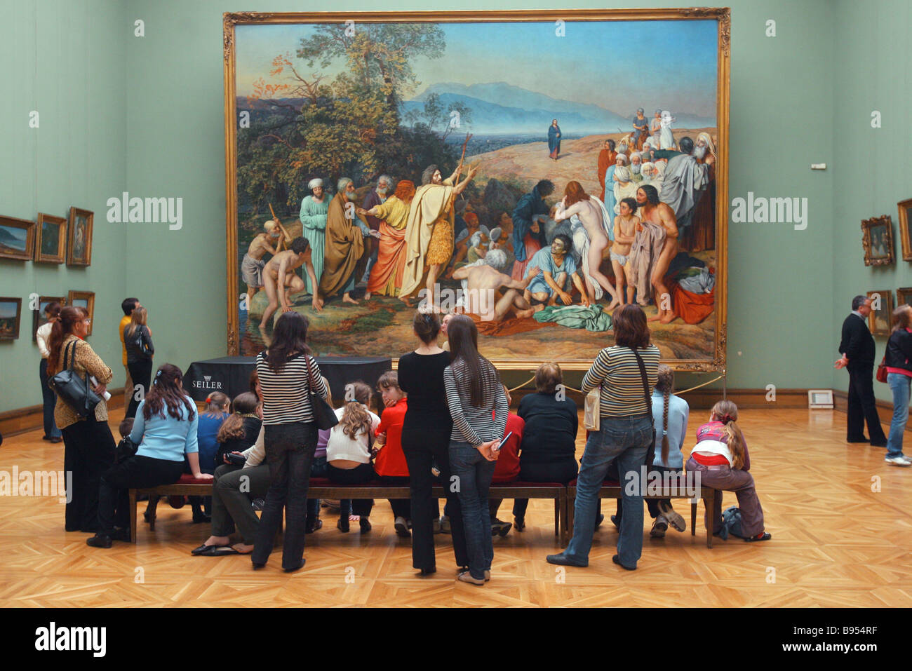 Visitors before Alexander Ivanov s The Appearance of Christ to the People at the State Tretyakov Gallery Moscow - Stock Image