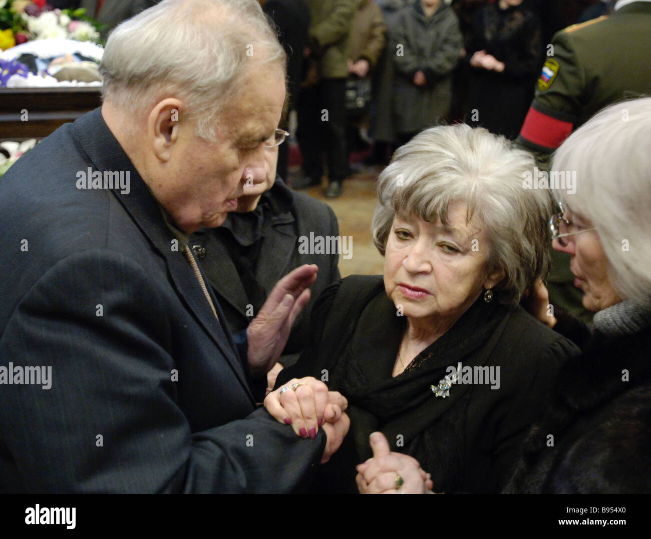 Film director Eldar Ryazanov expressing condolences to composer Andrei Petrov s widow center The civil funeral rites - Stock Image