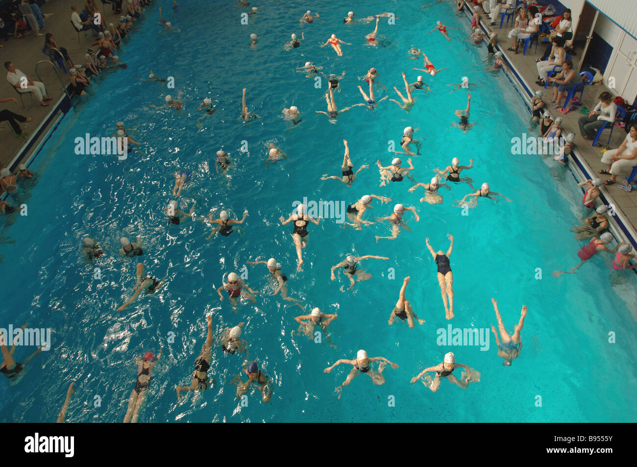 Synchronized swimming at Trud swimming pool before Moscow junior league tournament - Stock Image