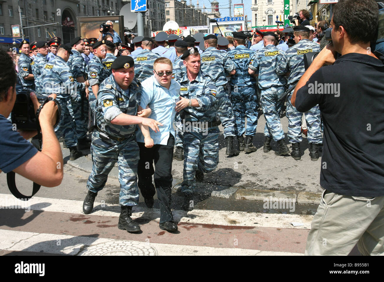 Police dispersing a demonstration of gay parade supporters in Moscow - Stock Image