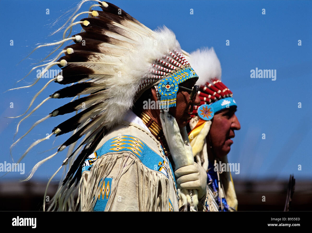 American plains Indians in war bonnets Blackfoot Reservation Browning Montana USA - Stock Image