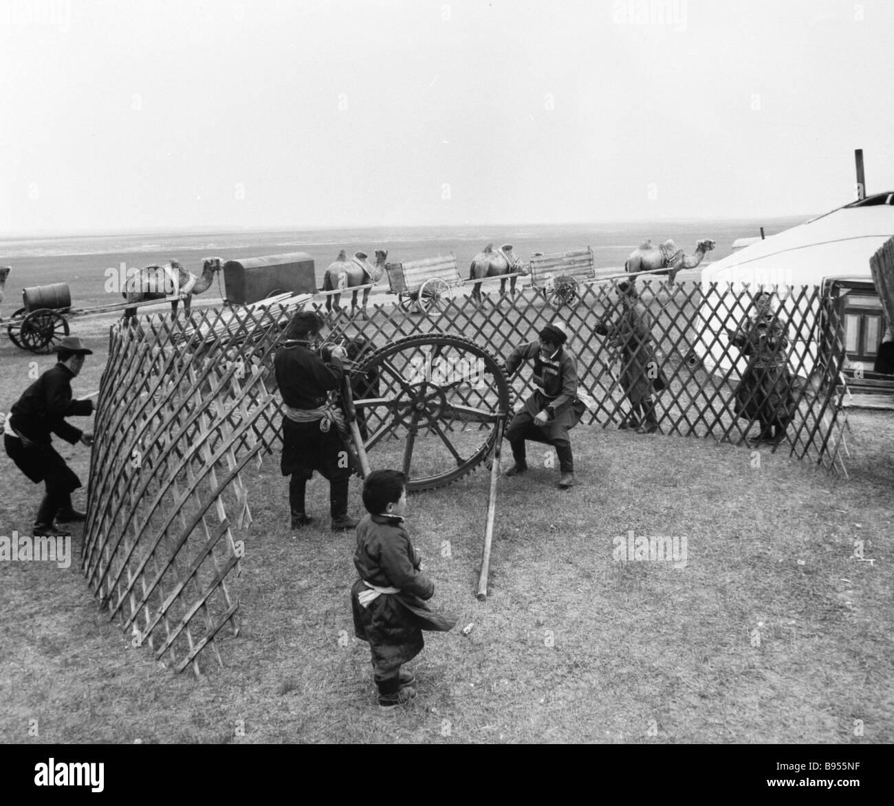 Buryats pitch a yurt Stock Photo