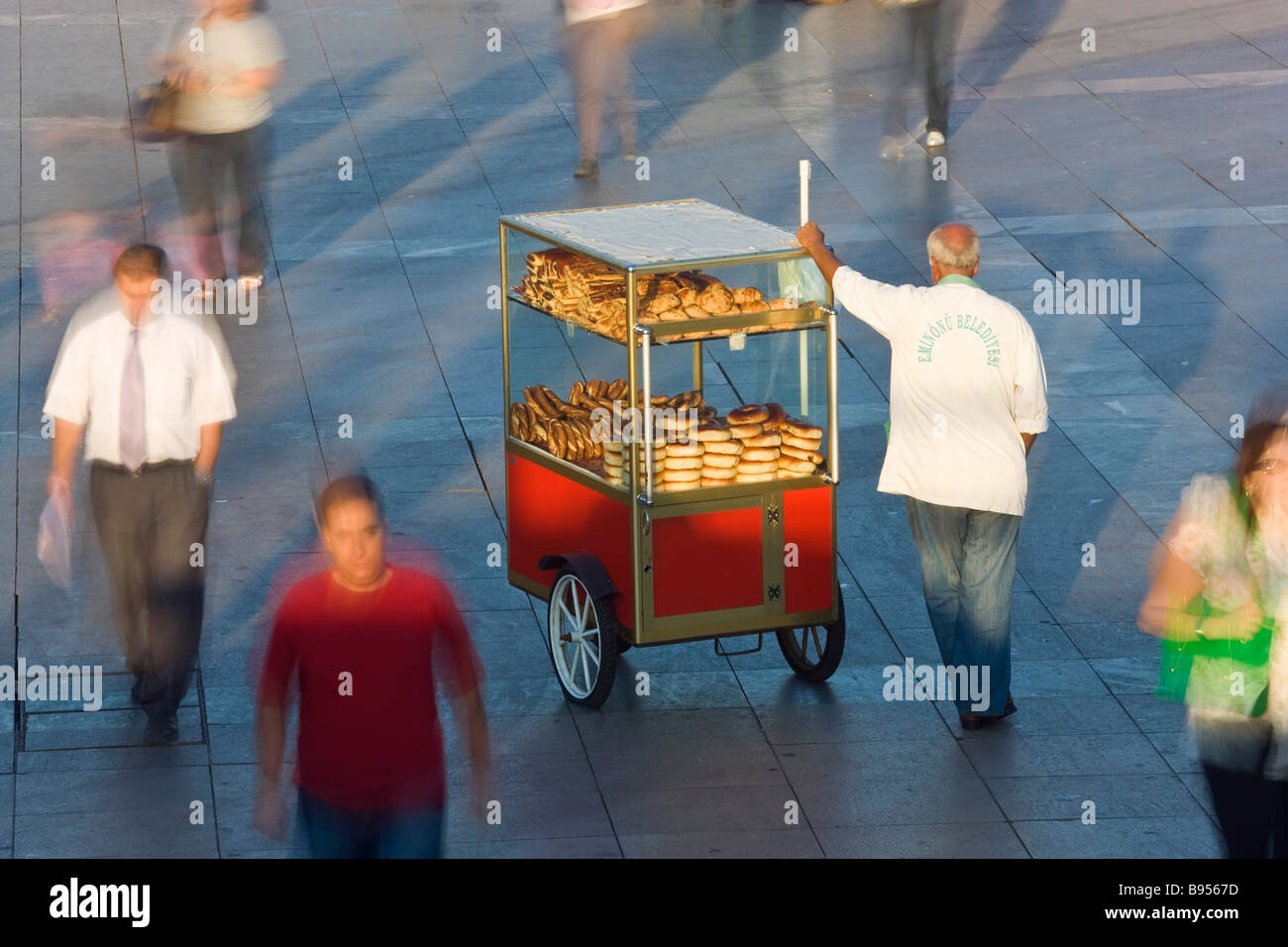 Bread snack seller during rush hour Istanbul Turkey - Stock Image