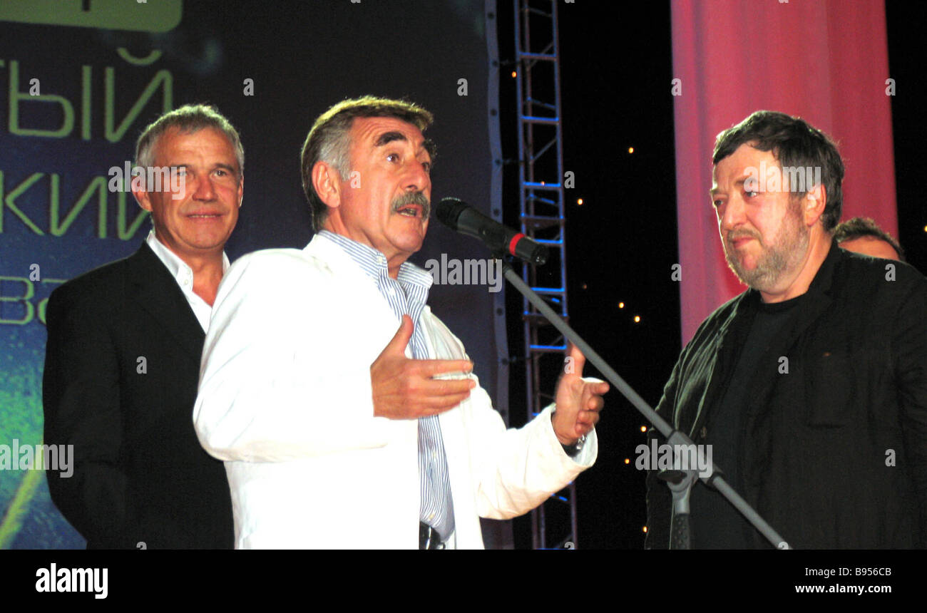 Director Pavel Lungin the winner of the grand prix for the movie Poor Relations actors Leonid Kanevsky and Sergei - Stock Image