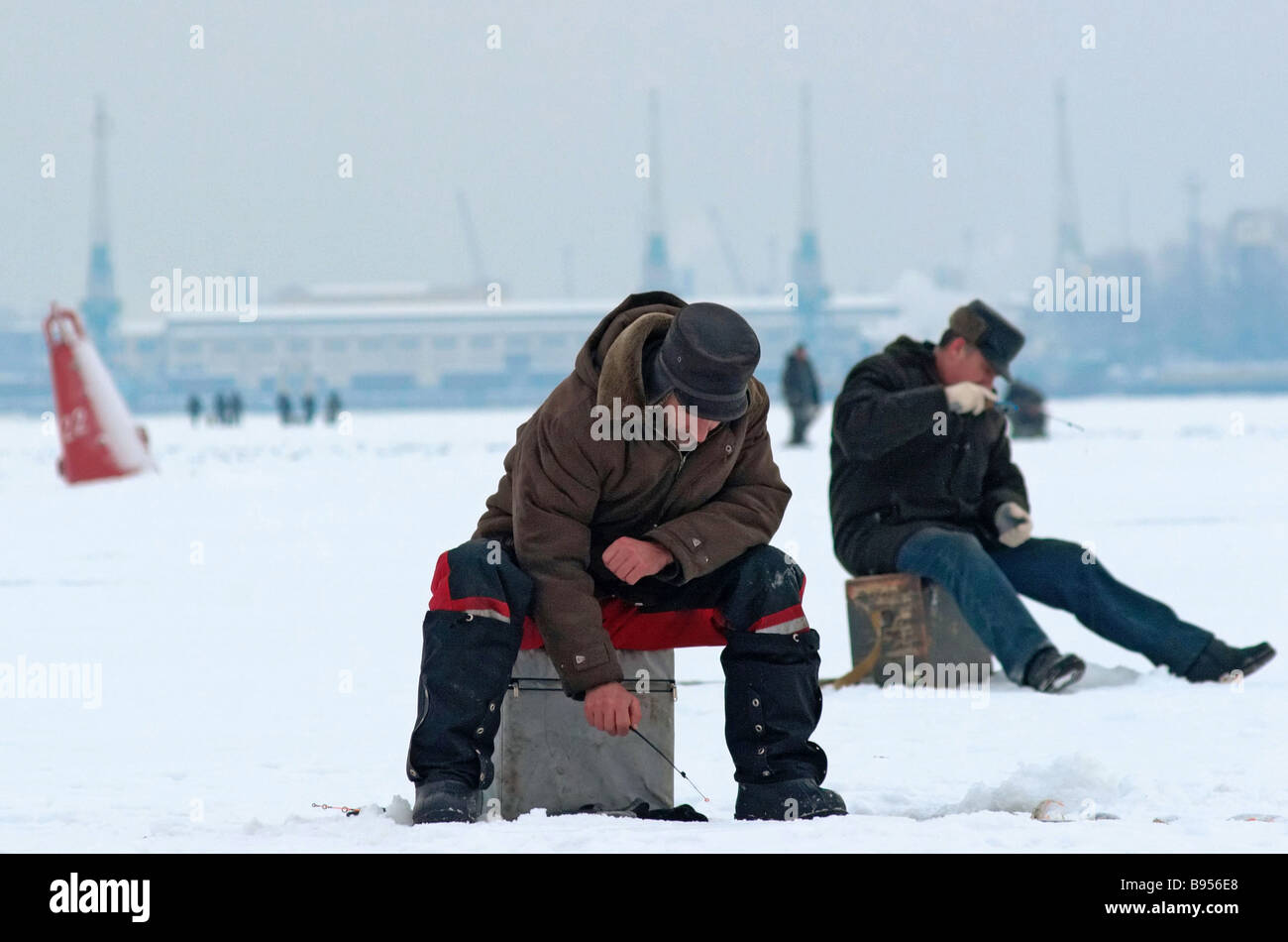 Fishing in the ice bound Gulf of Finland near St Petersburg Stock Photo
