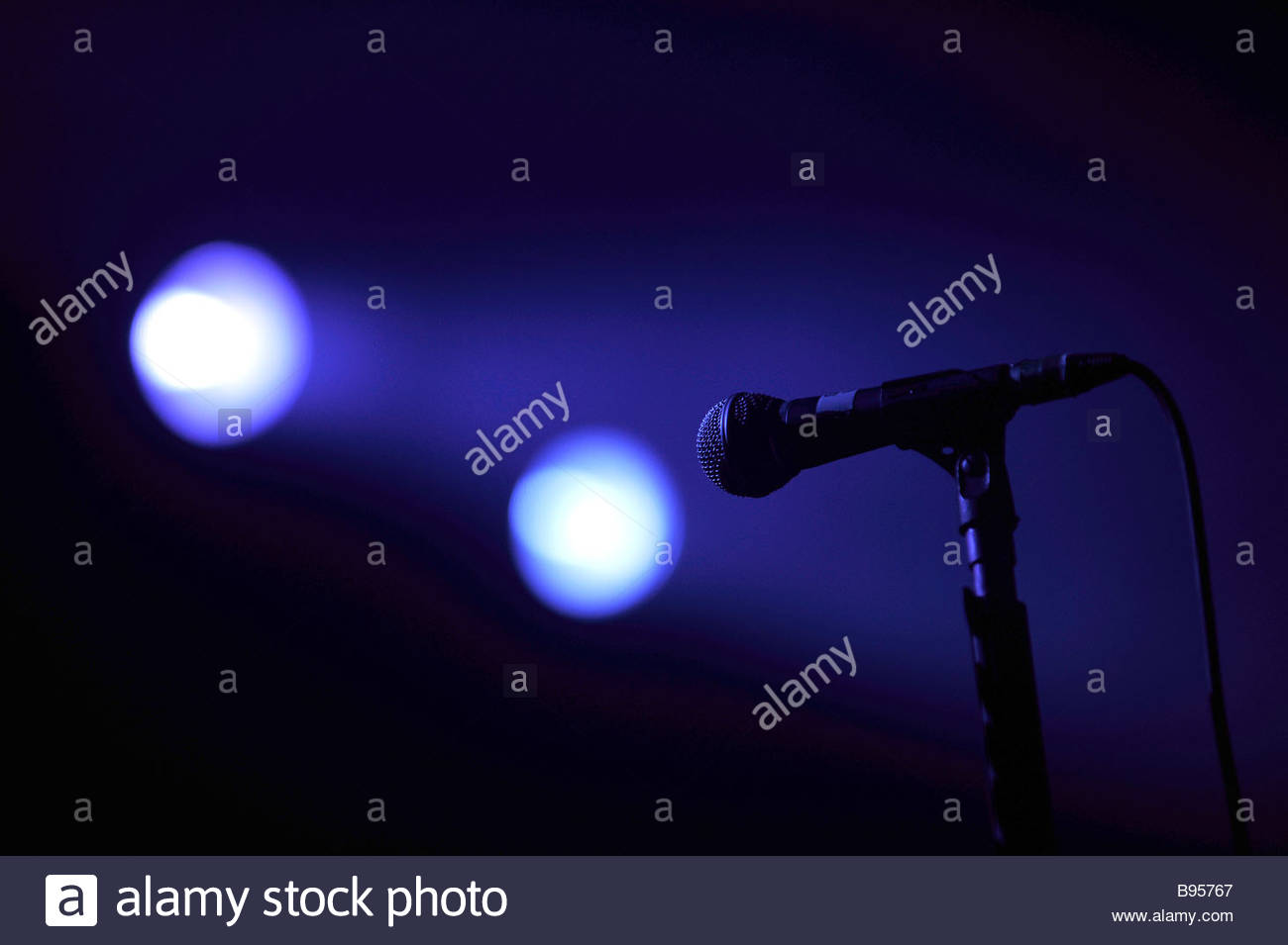 A mic and stage lights at a music gig uk - Stock Image