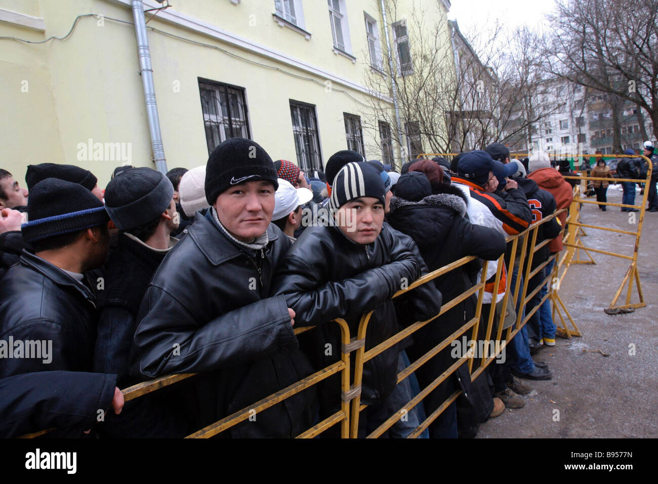 Tajik nationals standing in line for Russian employment visas The Russian Federal Migration s department in Moscow - Stock Image