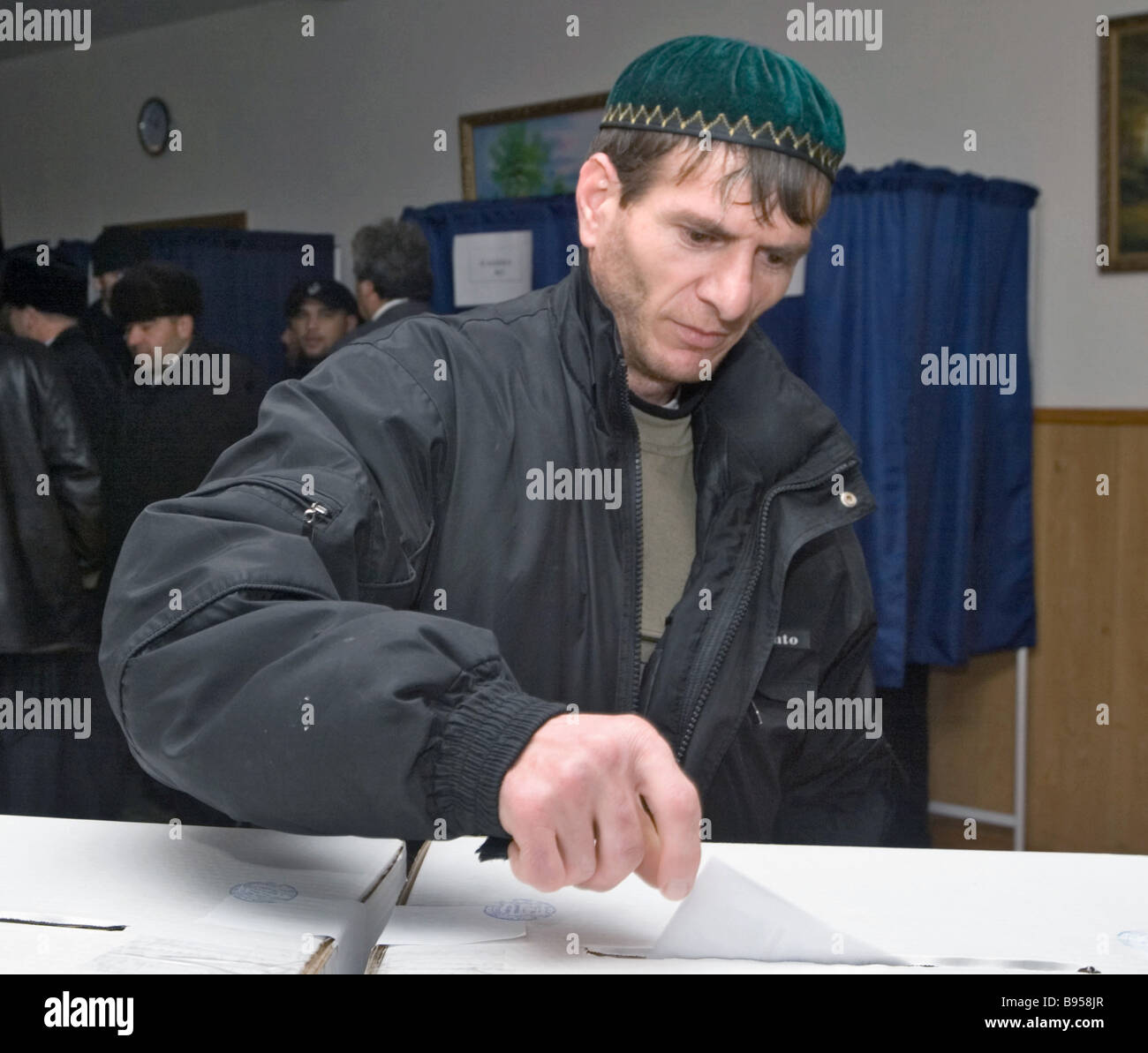 A voter in the Chechen village of Tsentoroi during the election of the fifth State Duma - Stock Image