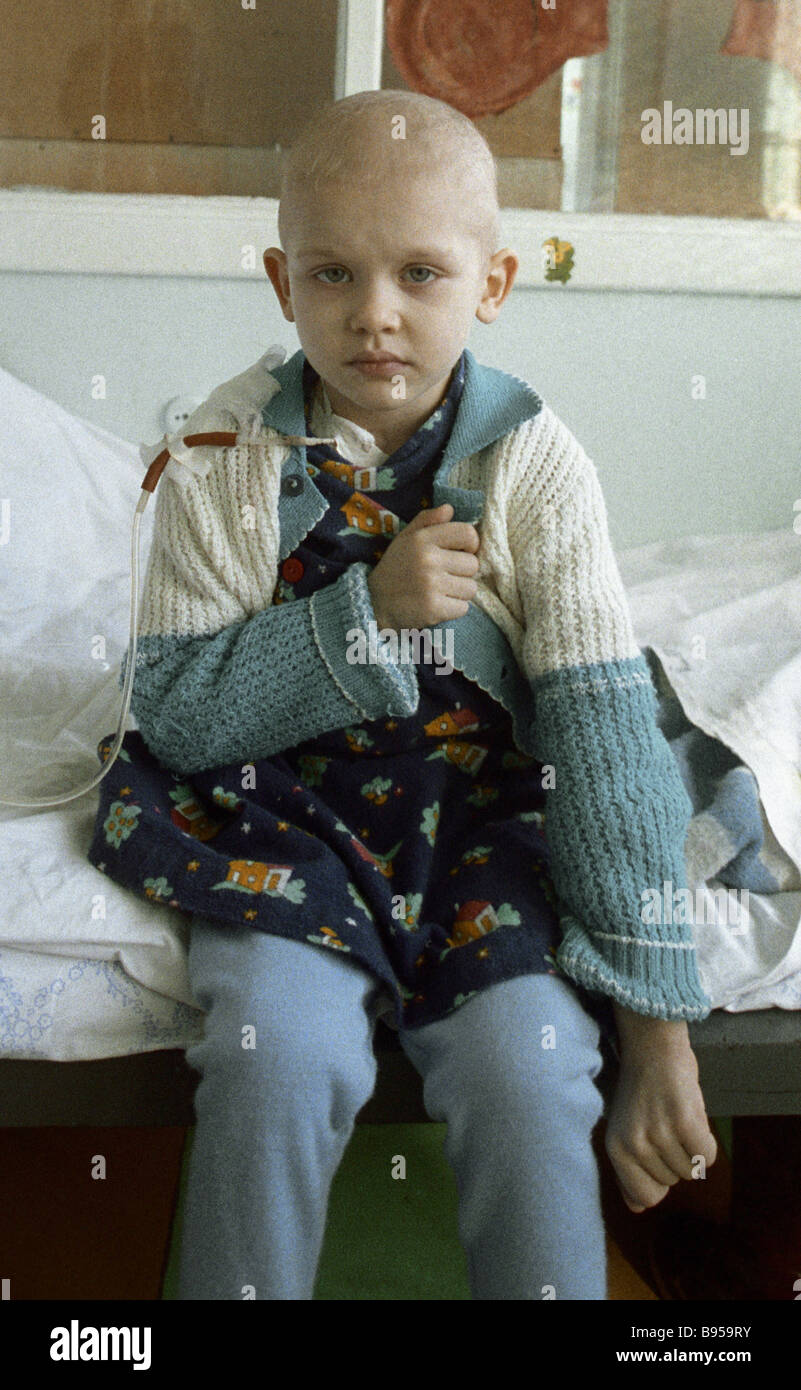 This little girl from the environs of Kiev was badly contaminated in the Chernobyl disaster and is now in the Minsk - Stock Image
