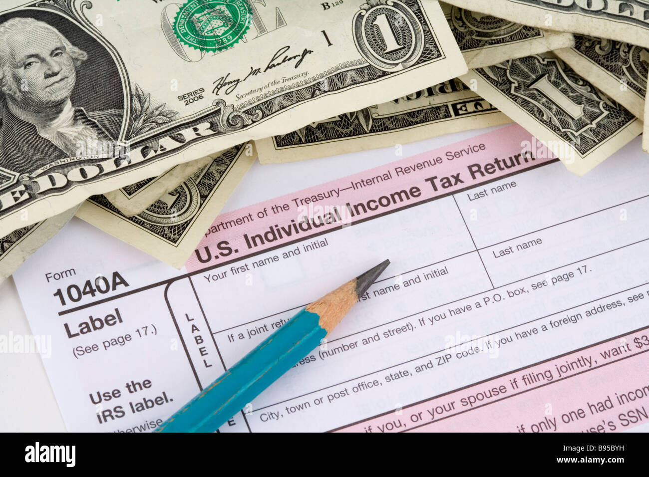 US tax forms and money - Stock Image