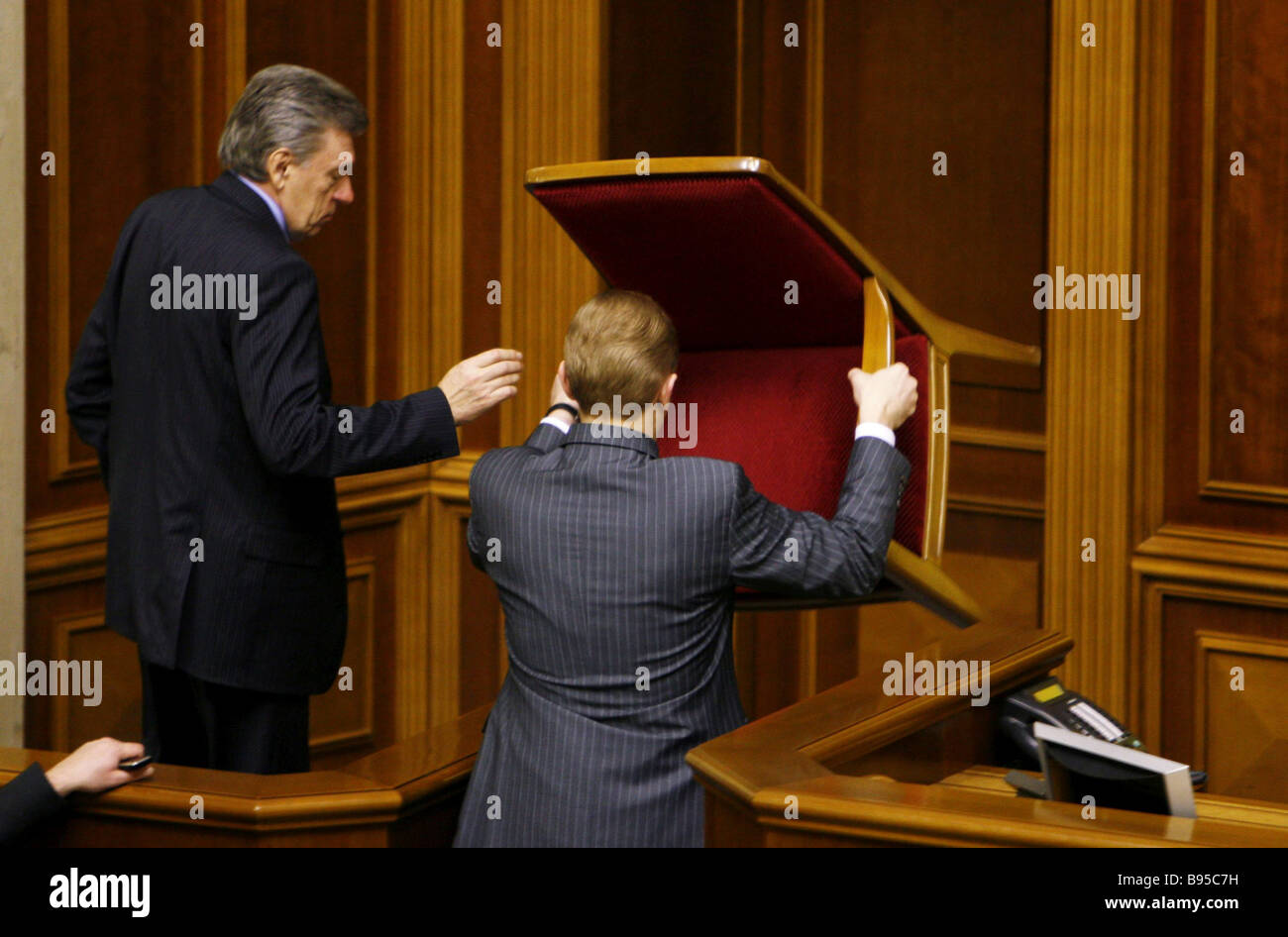 Members of the Party of Regions blocking the door to the debating chamber of the Ukrainian parliament - Stock Image