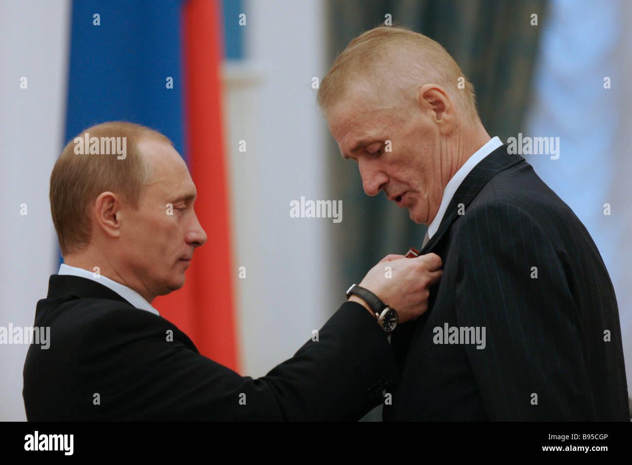 Russian President Vladimir Putin left awarding Alexander Abdulov actor of the Lenkom Theater the Order For Services - Stock Image