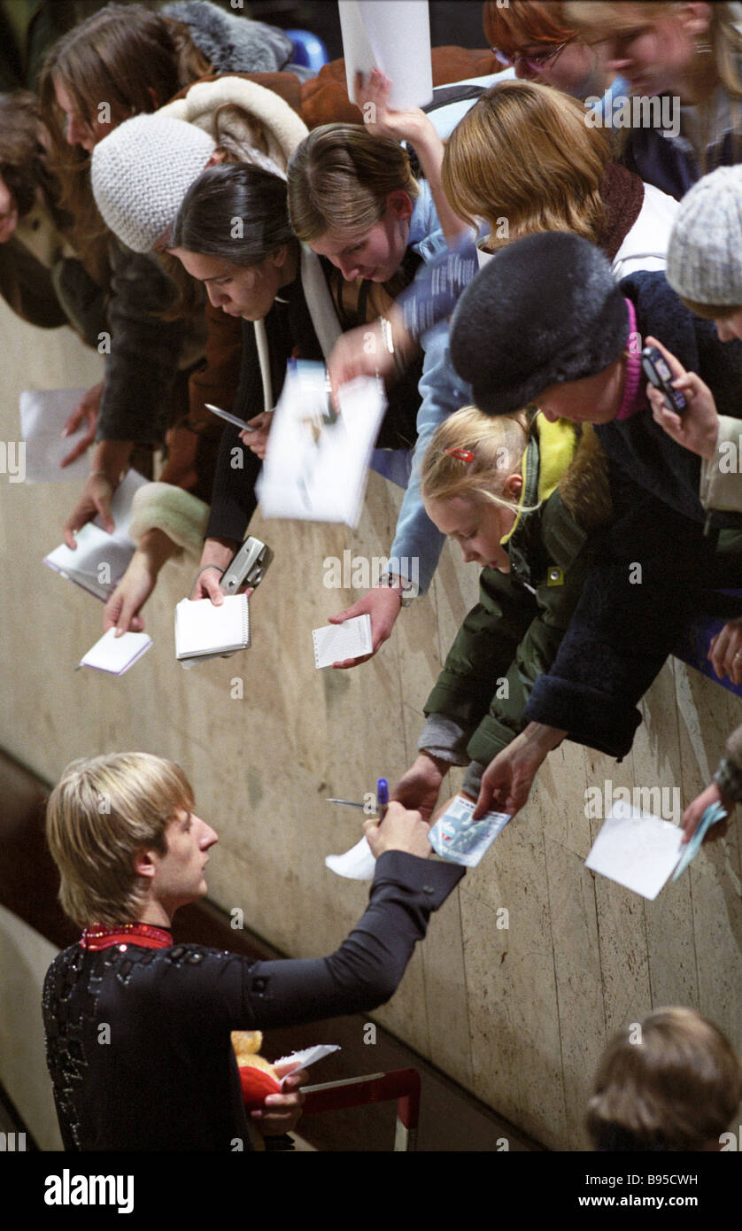 Winner of the sixth stage of the Cup of Russia Grand Prix figure skating Russian Evgeny Plyushchenko gives autographs - Stock Image
