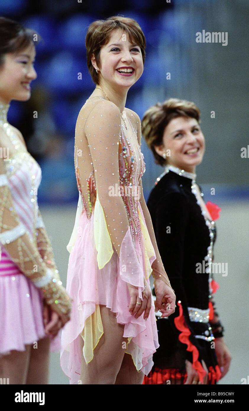Winner of the Cup of Russia Grand Prix figure skating Russian Irina Slutskaya centre Japanese skater Shizuka Arakava - Stock Image