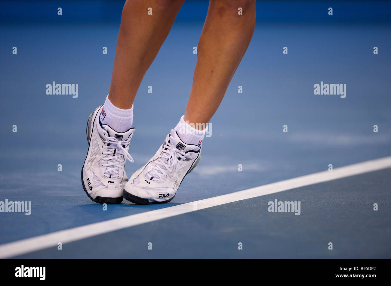 A female tennis player serves during the Australian Open Grand Slam 2009 in Melbourne - Stock Image