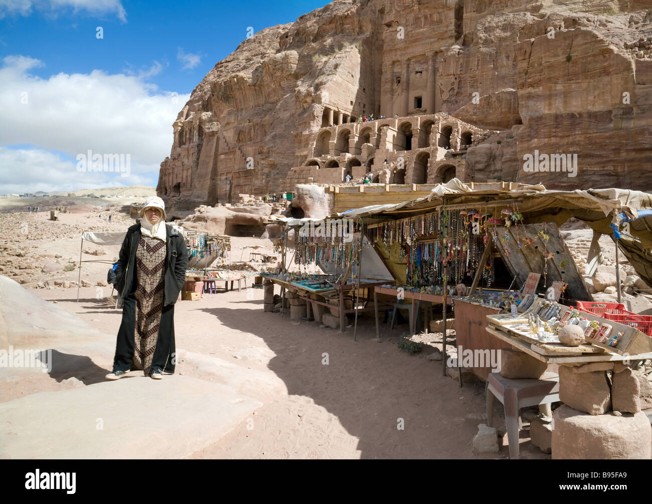 A shopkeeper selling souvenirs in Petra, Jordan - Stock Image