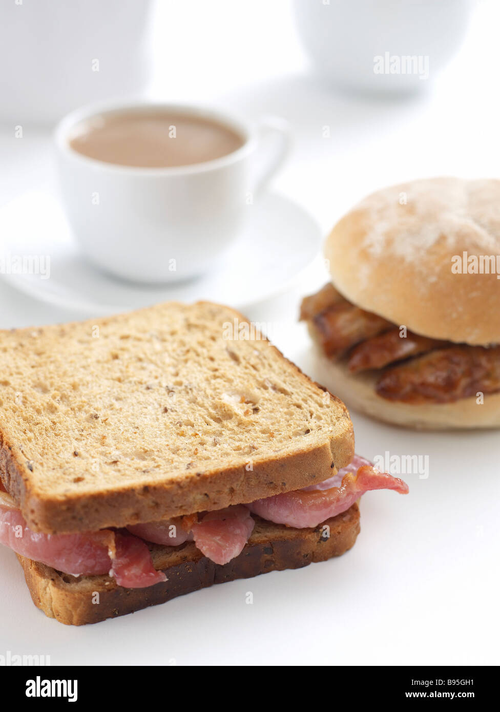 bacon sandwich and sausage bap Stock Photo