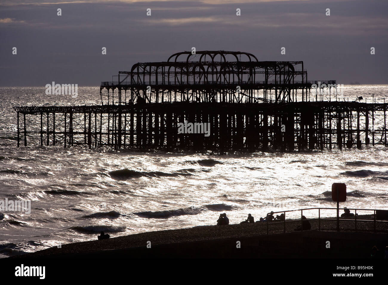 ENGLAND East Sussex Brighton Monochromatic silhouette of remains of West Pier at sunset - Stock Image