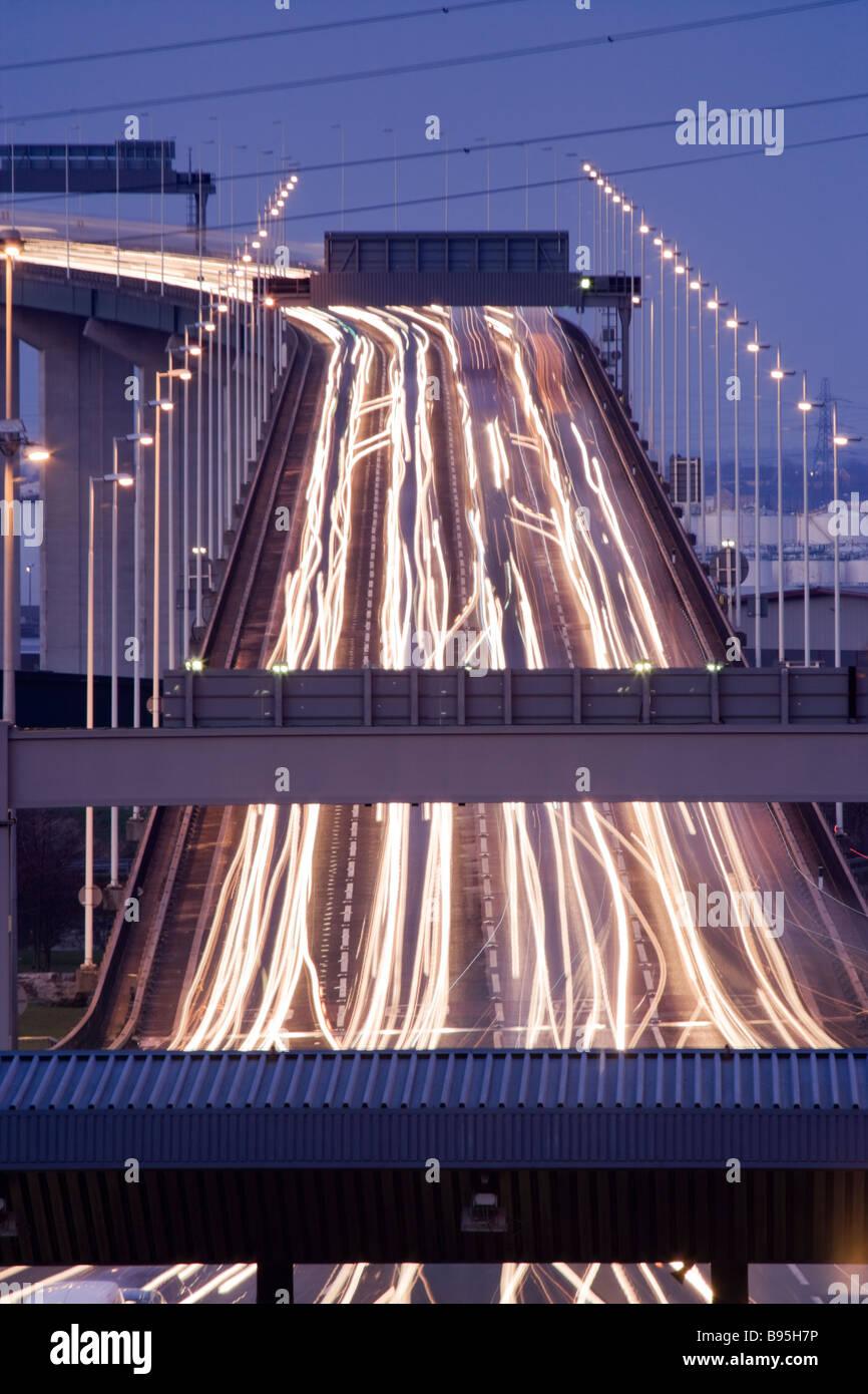 Traffic on Queen Elizabeth II Bridge at night, Dartford, Kent, UK - Stock Image