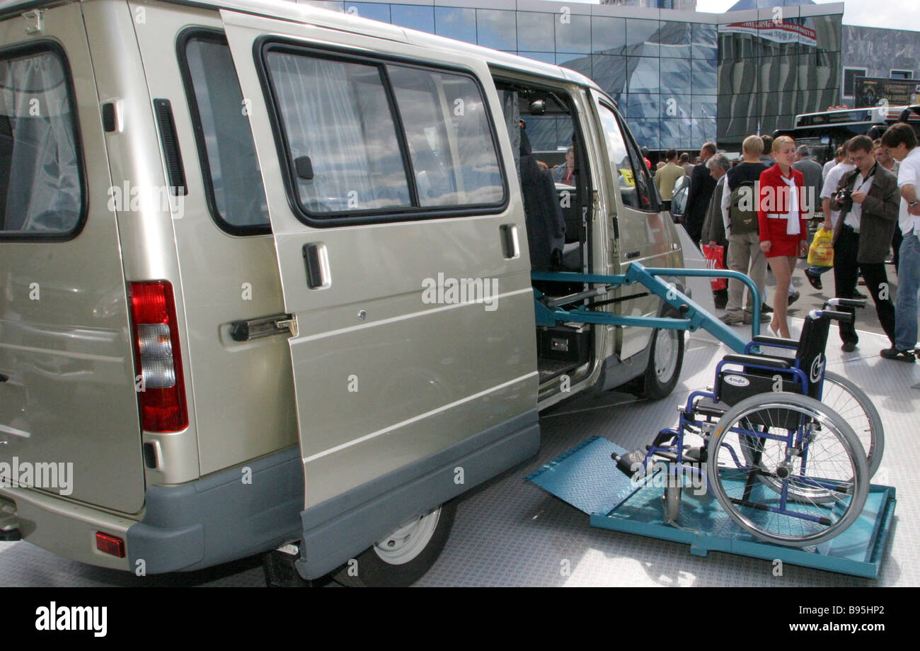 The hand geared Sobol car has a side hoist for a wheelchair It is exhibited in the welfare transport section of - Stock Image
