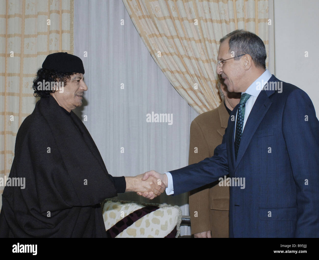 During a visit to Libya Russian Minister of Foreign Affairs Sergei Lavrov right meets with its leader Muammar al Stock Photo