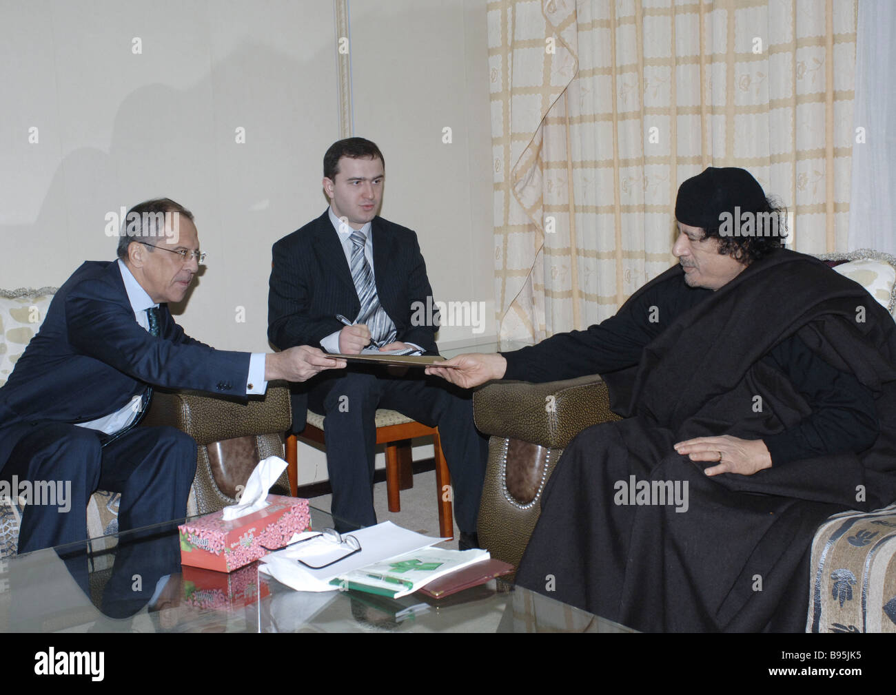 During a visit to Libya Russian Minister of Foreign Affairs Sergei Lavrov left met with its leader Muammar al Gaddafi Stock Photo
