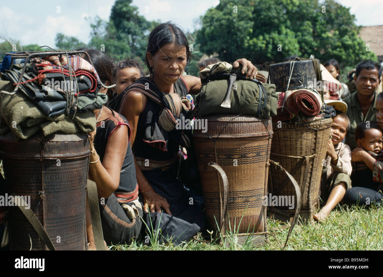 Vietnam War Central Highlands Siege of Kontum Montagnard refugees waiting for helicopter evacuation Stock Photo