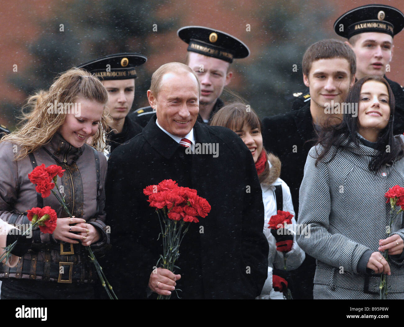 Russian President Vladimir Putin center with representatives of youth organisations in Red Square during the ceremony - Stock Image