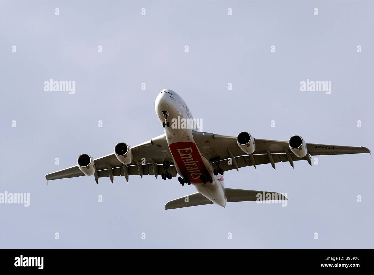 Emirates Airways new Airbus A380 long haul passenger aircraft prepares to land at London's Heathrow Airport - Stock Image