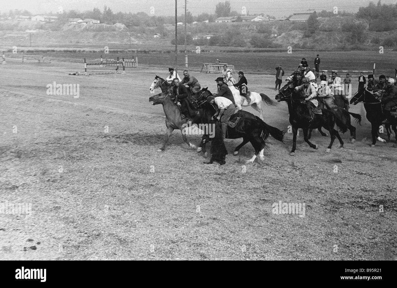 Racing for a goat carcass is one of the most popular Tajik folk equestrian sports - Stock Image