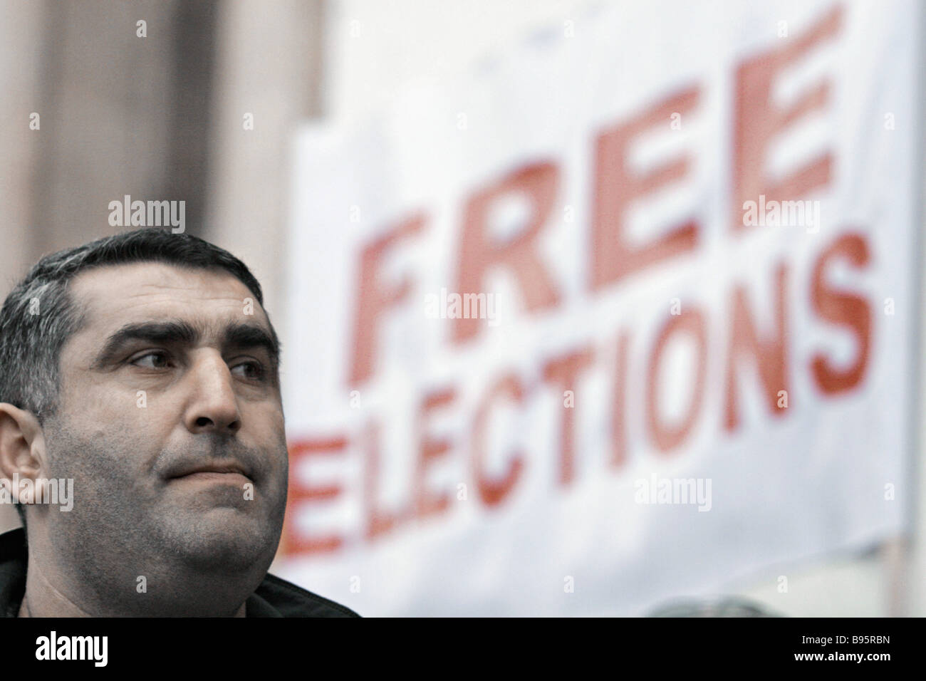 A Georgian opposition demonstrator protesting in Tbilisi - Stock Image
