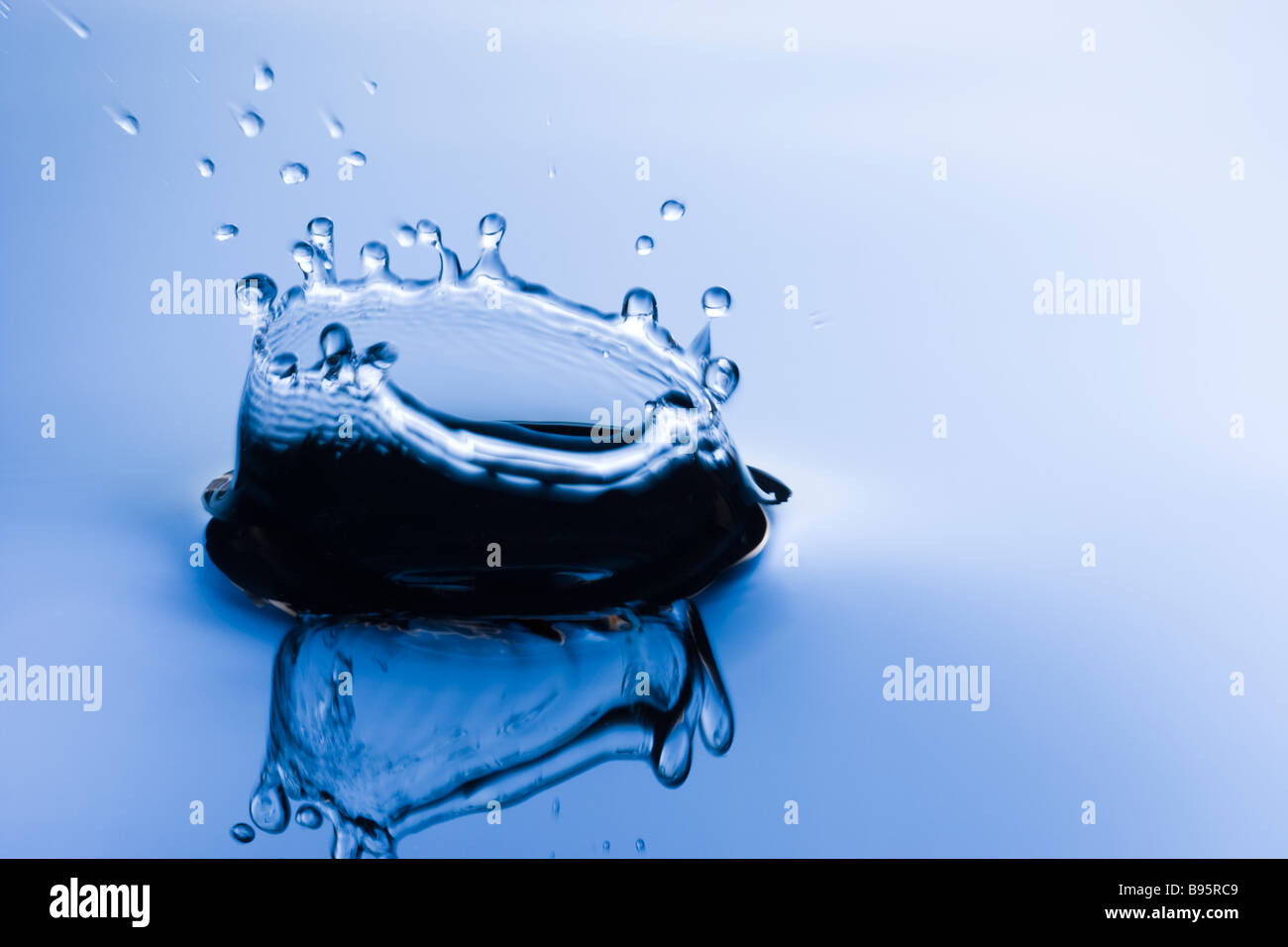 Splash in water - Stock Image