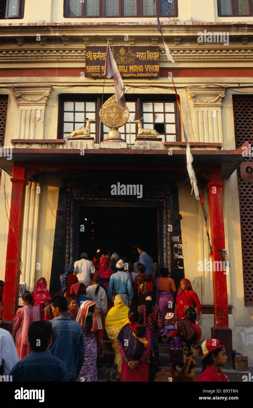 NEPAL Kathmandhu Valley Swayambhunath Buddhist pilgrims at temple stupa entrance. - Stock Image