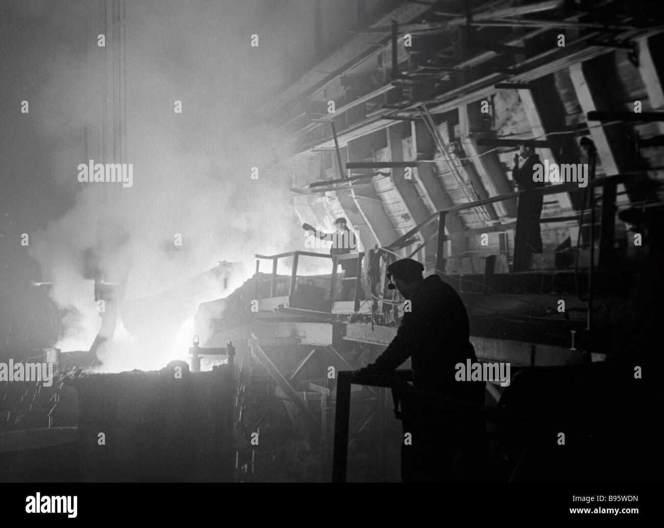 A steelmaker controlling hot metal flow in a blast furnace hearth Stock Photo
