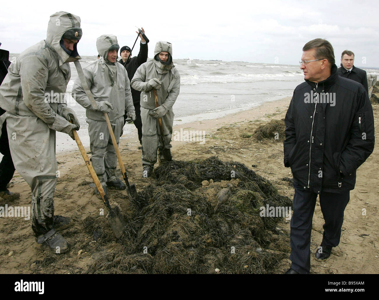 Prime Minister Viktor Zubkov at the scene of the disaster cleanup operations in the port of Kavkaz - Stock Image