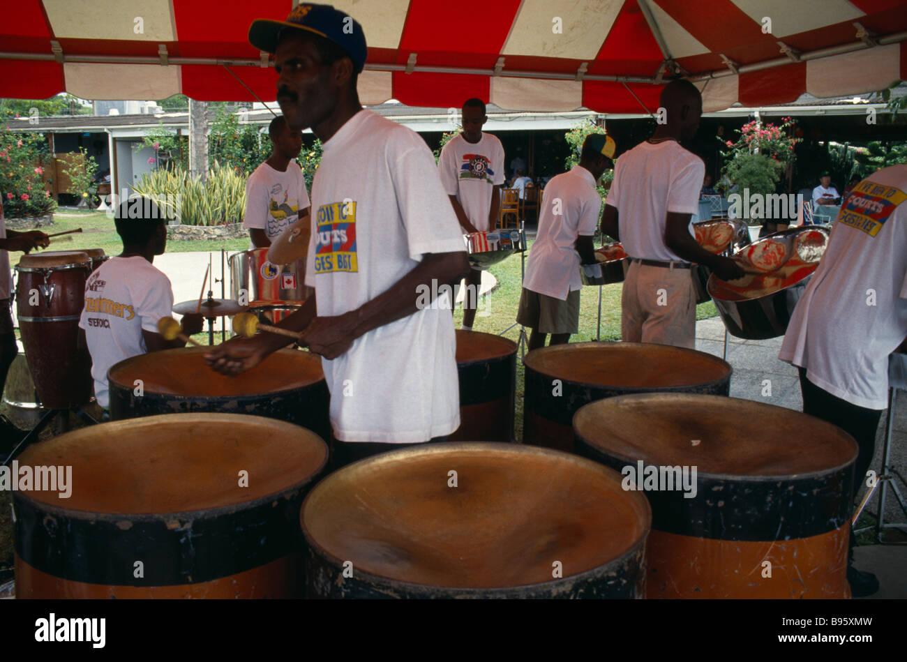 West Indies Caribbean Tobago Music Percussion Katzenjammer steel band men playing pans - Stock Image