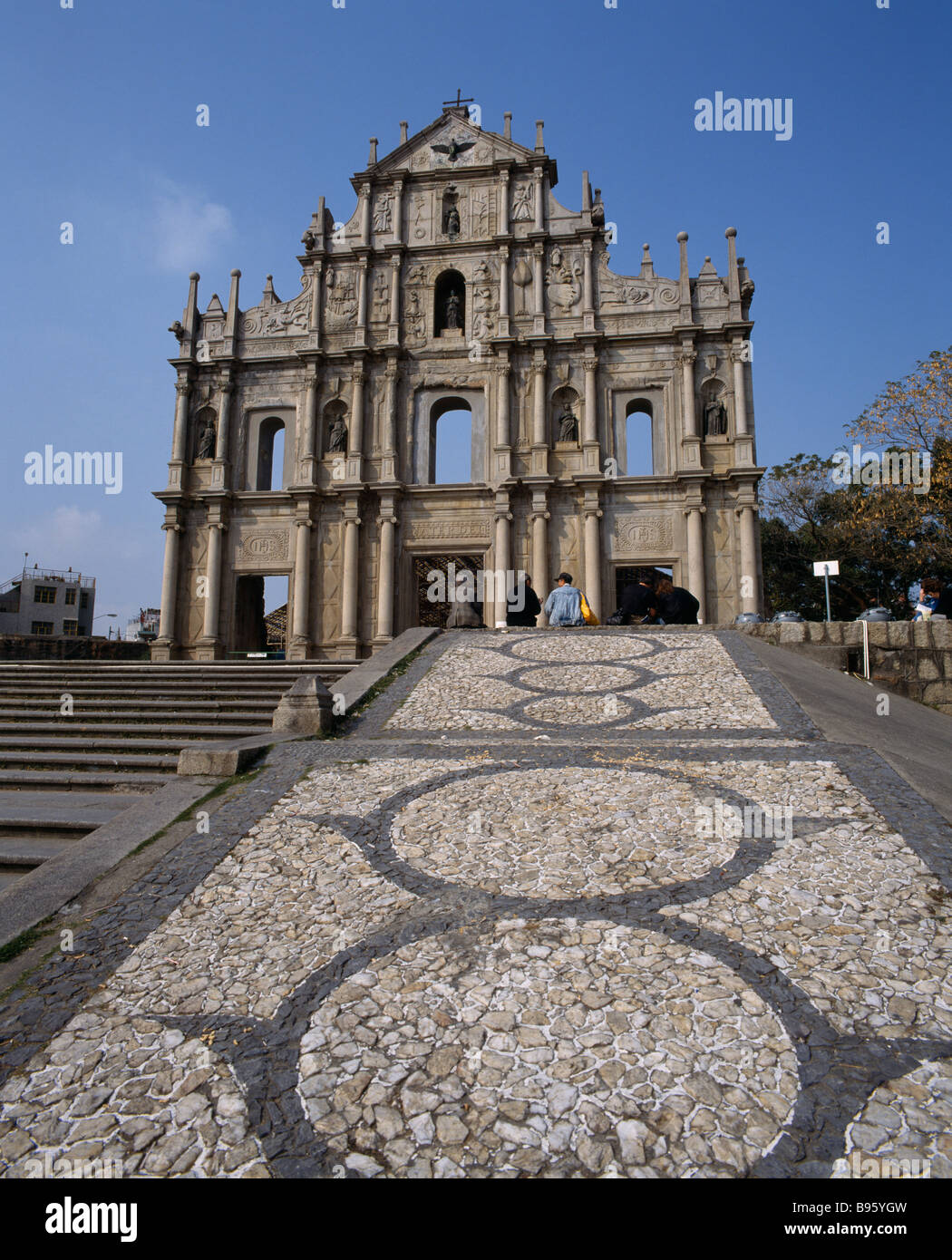 MACAU  Sao Paulo Church remains with statues in recessed arches and mosaic path - Stock Image